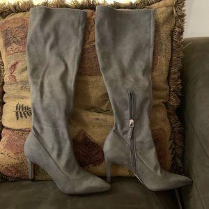 Below the knee high heels boots